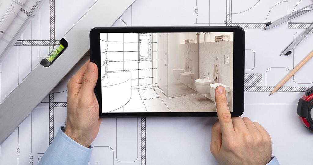 Ein Foto von einem Badezimmer wird mit einem Ipad aufgenommen